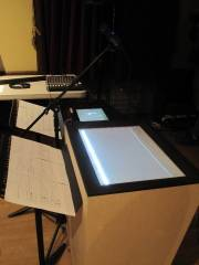 The TactoSonix hardware and a JazzMutant Lemur device, in a concert setting. Note IDMIL's dimple software running on the multitouch table.